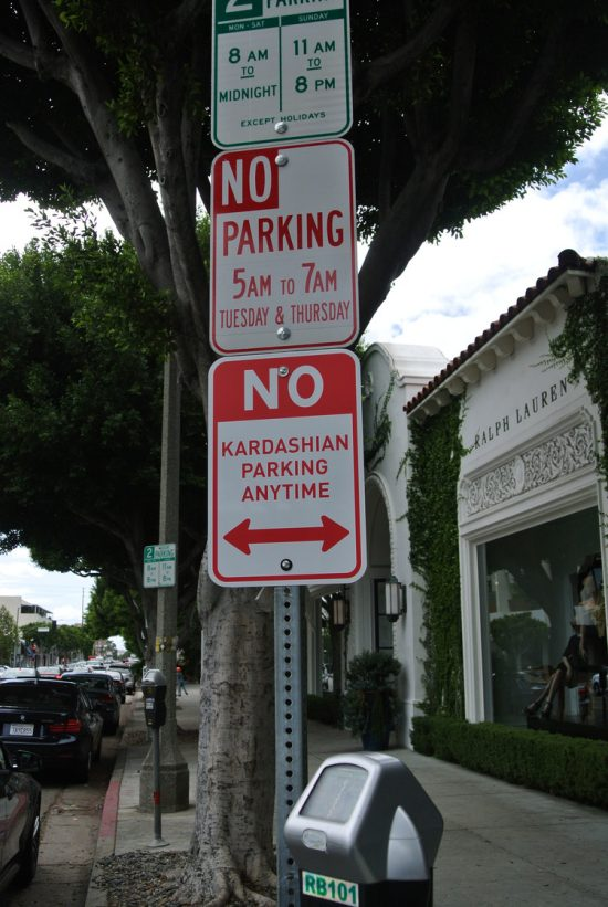 "If LA parking signs weren't confusing enough some residents now have an additional sign to deal with - LA Street artist installs "" No Kardashian Parking signs"" The artist - Plastic Jesus - said the the signs are intended as a comment on the media's attention on a family going about their every day business, shopping, going to lunch, pumping gas… How have this become a news event - the signs have been installed at 7 locations around LA, including Melrose Avenue, Robertson Ave near The Ivy and La Brea."