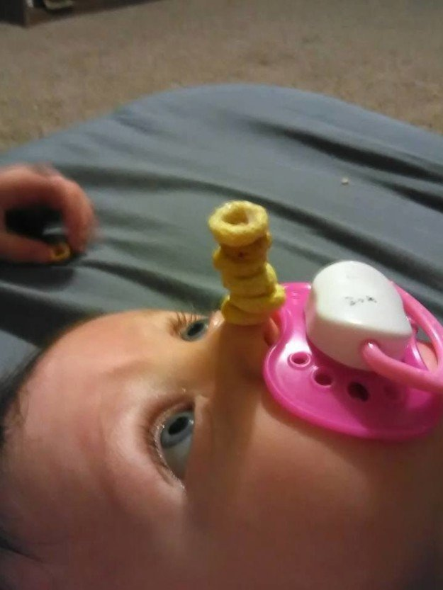 Others have taken great risks, stacking Cheerios upon their babies who are awake.