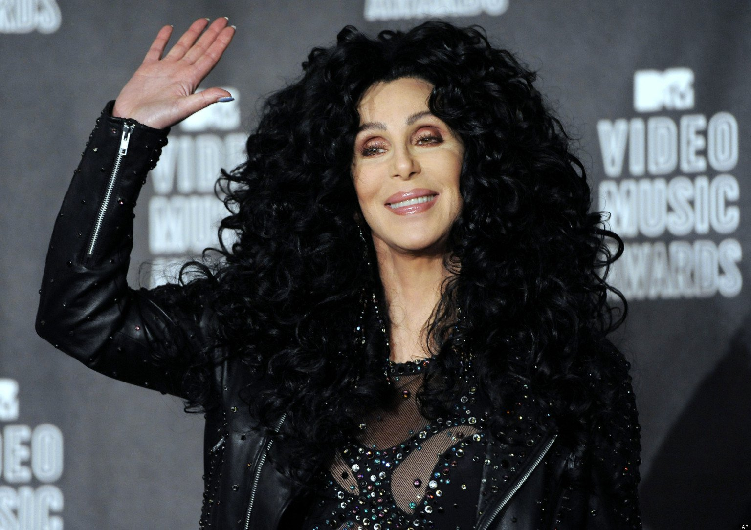 FILE - In this Sept. 12, 2010 file photo, Cher poses in the press room at the MTV Video Music Awards in Los Angeles. (AP Photo/Chris Pizzello, file)