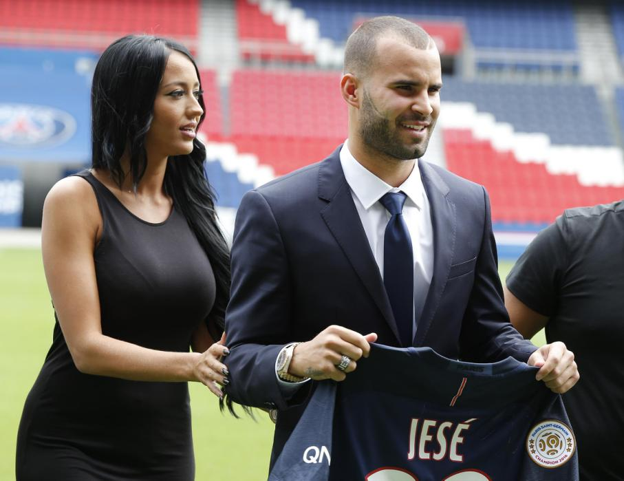 Spanish soccer player Jese Rodrigez, and his companion Aurah Ruiz, left, stand next to each other as they pose for photographers at Parc des Princes stadium in Paris, Monday, Aug. 8, 2016. French champion Paris Saint-Germain bolstered its attack by recruiting Spanish forward Jese on a five-year deal from Real Madrid. (AP Photo/Michel Euler)