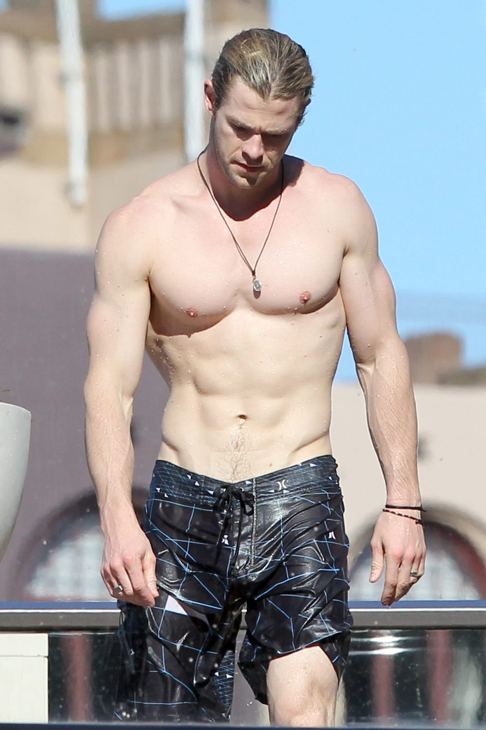 Chris Hemsworth shows off his ripped body as he chills by his hotel pool. Pictured: Chris Hemsworth Ref: SPL407263 180612 Picture by: Blue Wasp/Grey Wasp/Splash News Splash News and Pictures Los Angeles:310-821-2666 New York: 212-619-2666 London: 870-934-2666 photodesk@splashnews.com